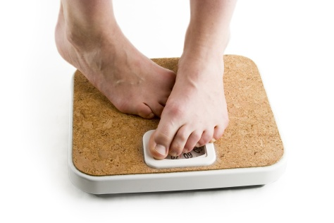 a pair of female feet standing on a bathroom scale looking shy about the weight  THINNER. THINNER   Bernadette  39 s Writing Spot